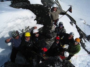 Climbers celebrate a group summit in Alaska.
