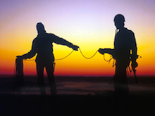 Climbers coil their rope at the end of a great day at Mt. Erie.