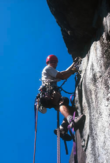 Climber using aid techniques on big wall route.