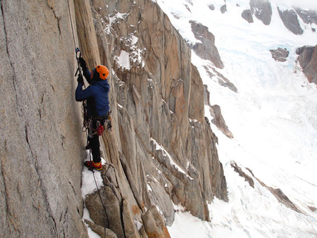 Climber working his way up Cerro Torre in Patagonia, Argentina.