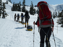 A group practicing sled hauling at the Mt. Baker Ski area.