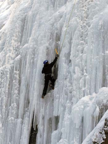 A climber top ropes a steep and chandeliered curtain of ice in the Ouray Ice Park.