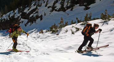 A group of skiers skin uphill in the Washington Pass backcountry.