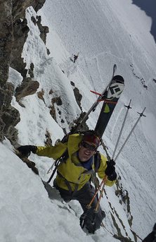 Skier Mike Arnold climbing up the rock traverse to the Col de Beaugeant in Chamonix, France.
