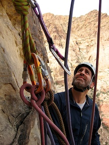 A climber belaying a leader in Red Rock Canyon. Scott Massey