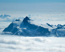A view from Mt. Baker of Mt. Shuksan and the Sulphide glacier peeking through the dense clouds