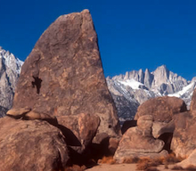 Climbing in the Alabama Hills with Mount Whitney in the background.