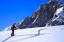 An AAI guide skis towards the Southwest Ridge of Mount Frances on the Kahiltna Glacier.
