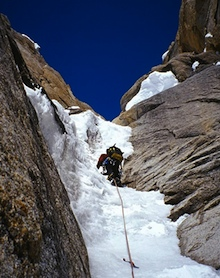 An AAI guide high in the Ham and Eggs couloir on the Moose's Tooth.
