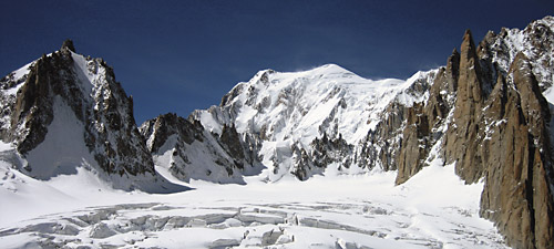 French Alps classics, from left to right: Tour Ronde, Mont Blanc, Grande Capucin (rock spire on right), Pyramid du Tacul (lower rock spire), and Mont Maudit (upper right background).