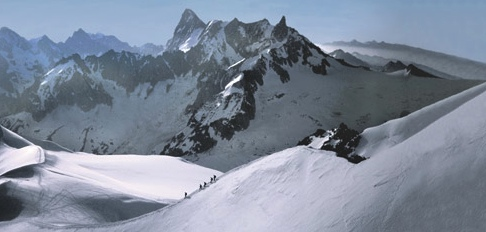 Climbers descending the Aiguille du Midi, with the North Face of the Grandes Jorasses in the background.