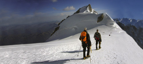 Two climbers approaching Mt. Maudit after successfully climbing Mont Blanc.