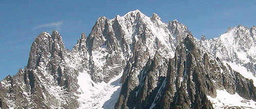 The Aiguille du Dru (left) are an extension of the west ridge of the Aiguille Verte (centre)