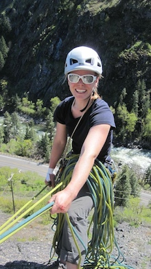 AAI Guide Erin Smart smiles at a belay station in Leavenworth.
