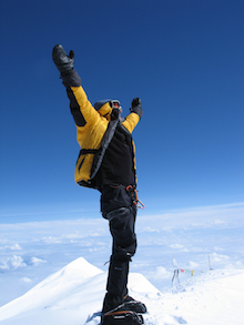 An ecstatic climber at the summit of Denali.