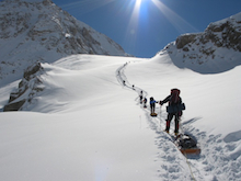 Advancing camp on Denali with full sleds.