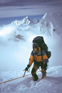A climber pauses during the physical ascent of the West Rib.