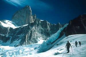 Climbers on the Glacier de los Tres approaching Cerro Velluda with the East Face of Fitzroy in the background.
