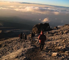 Climbers descend after a successful summit on Kilimanjaro.