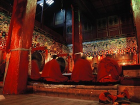 China, Reddomaine - Monks of the Kangding Monastery during their morning sutras.