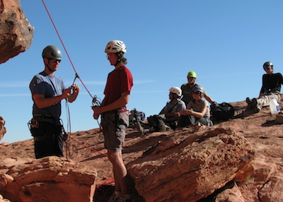 AAI Guide Jason Martin instructing a group of SPI Candidates on rock rescue techniques in Red Rock, Nevada.