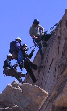 A climber works a high-end rescue scenario with multiple patients.