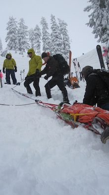 A patient is hauled on steep-angle terrain just outside Mount Baker Ski Area.