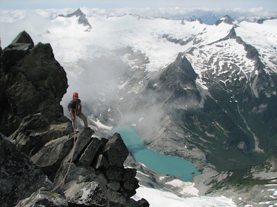 Climbing the picturesque West Ridge of Forbidden Peak with Eldorado in the background.