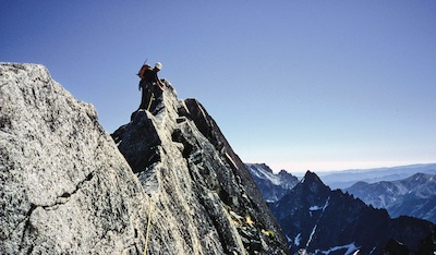 A climber enjoying the phenomenal exposure on the N. Ridge of Mt. Stuart