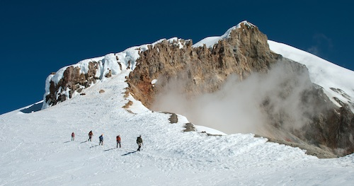 An AAI team descends Pumice Ridge after a successful climb of the Easton Glacier route on Mt. Baker