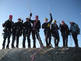 A Leaders of Tomorrow group celebrates on the summit of Mt. Baker.