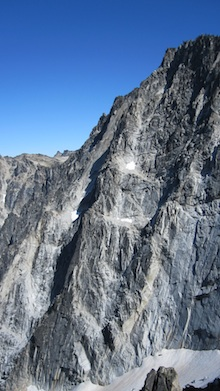The many ridges of Dragontail Peak rise sharply from Colchuck Lake and offer spectacular climbing opportunities.