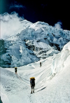 A rope team navigates through complex glacial terrain on a climb of Huascaran.